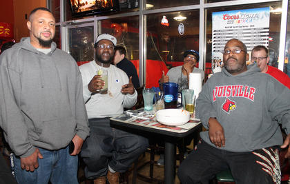 It was a mixed group of Seattle Seahawks and New England Patriots fans who watched the Super Bowl together at this table at Buffalo Wings and Rings Sunday night. From left Andre Staples (Patriots fan), Cedric Spalding (Pats), David Brown (Sehawks), Nick Sipes (Hawks) and Ron Cowherd (Pats). The Patriots won their fourth NFL world title.