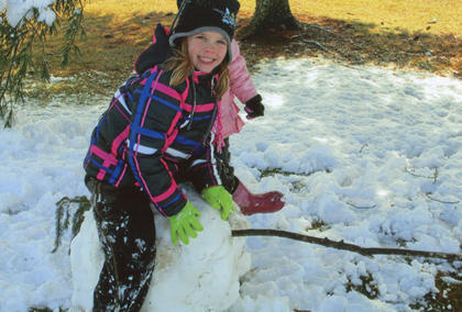Ragen Sympson riding her very own creation, a snow horse.