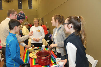 Members of the St. Joseph W.O.W. teen group served creamy chicken tortilla soup at the Souper Bowl of Caring competition at St. Joseph Hall to benefit the St. Vincent de Paul food pantry. They also organized and hosted the event.