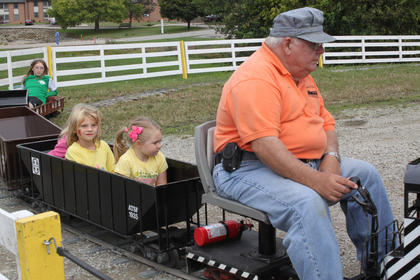 Joe Fetter, with the Falls City Live Steamers, drives the train while his passengers, Kelsey Brook Milburn, 2, Chaeli Carter, 7, Nadia Sullivan, 4, and Cassie Carter, 11, take a ride.