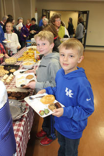 Caleb Mattingly, right, and his friend Parker Osborne load up on sweets and strawberries at the Souper Bowl of Caring at St. Joseph Catholic Church Saturday. The pre-Super Bowl event is a fundraiser or the St. Vincent de Paul food  pantry.