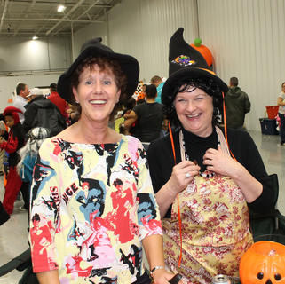 Witches Pam Ball and Terry Martendill with Town and Country Bank and Trust Co. are amused by the children at the Halloween party.