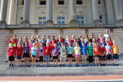 """Third-grade students at St. Joseph Elementary School took the """"Kentucky Standard"""" along on a field trip to Frankfort on May 15. The students and their teachers, Katrina Ballard and Karen Meredith, toured the Capitol building, visited the Vietnam Memorial, and the gravesite of Daniel Boone."""