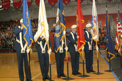 Nelson County Air Force Junior ROTC students Dylan Maze, Channing Ingram, Brenden Luckett, Abby Spratt and Blake Crepps honor the different branches of the military (Army, Navy, Marine Corps, Coast Guard and Air Force) by presenting a flag of each one of the branches during the Veterans Day ceremony Monday at Nelson County High School.