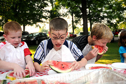 Addison Lucas, Aiden Lucas and Lewtin Yates chow down during a watermelon eating contest before a special performance of The Stephen Foster Story at the J. Dan Talbott Ampitheatre Saturday.
