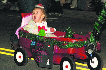 Bardstown Baby Buttermilk Festival Queen Austin Early gets pulled along in a wagon during the parade. She is the daughter of Amelia and Daniel Early.