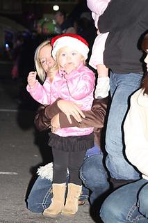 Emery Newton, 3, watches the parade with her mom, Robin Thompson.