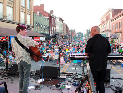 Bardstown/Australian folk-rock musician Pauly Zarb, right, joins 1995 national fingerpicking champion Pat Kirtley onstage at Pauly Zarb's 2011 Bardstown Street Concert on North Third Street in Bardstown July 9. Bardstown Main Street Manager Rita Riley estimated the event drew a crowd of 2,500 or more.